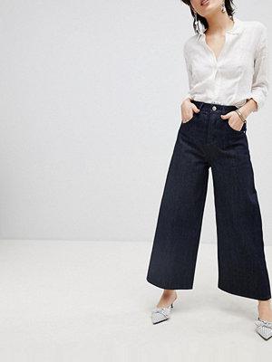 ASOS DESIGN Premium Indigofärgade jeans med vida ben Indigo