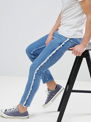 ASOS DESIGN Skinny Jeans in Mid Wash Blue With Frayed Side Stripe - Mid wash blue