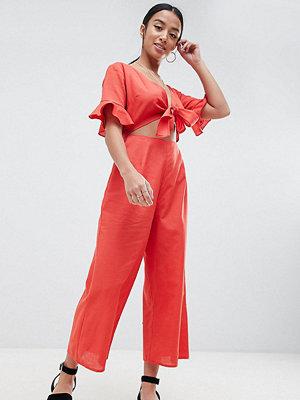 ASOS Petite ASOS DESIGN Petite tea jumpsuit with cut out and tie detail in linen - Dark orange