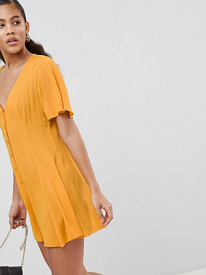 Asos Tall ASOS DESIGN Tall Swing Playsuit With Button Detail - Mustard