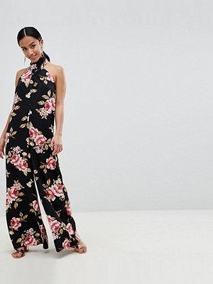 ASOS Petite ASOS DESIGN Petite Cross Front Jumpsuit With Wide Leg In Floral Print - Floral print