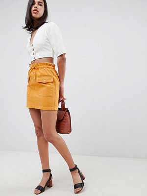 ASOS DESIGN denim paperbag skirt in mustard - Mustard