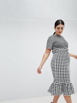 ASOS Curve ASOS DESIGN Curve midi dress with pep hem in contrast check - Black