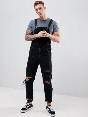 ASOS DESIGN Skinny Denim Dungarees In Black With Heavy Rips