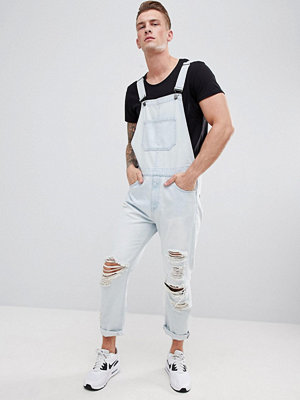 ASOS DESIGN Skinny Denim Dungarees In Light Wash Blue With Heavy Rips - Light wash blue