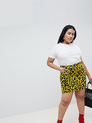 ASOS Curve ASOS DESIGN Curve denim original skirt in leopard print - Yellow/ black