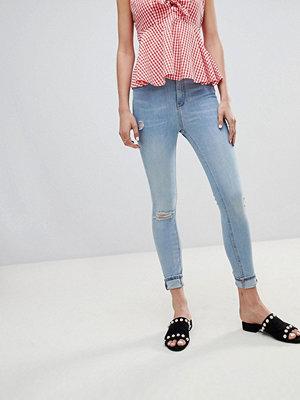 River Island Harper Skinny jeans med revade knän och sliten fåll Super ljusblå