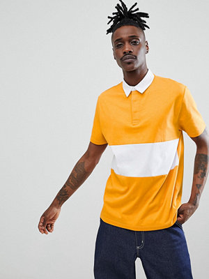 ASOS DESIGN rugby polo shirt with contrast panel in yellow - Jarlsberg/ w