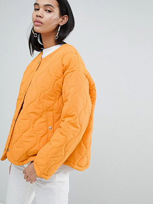 Weekday Limited Edition Quilted Padded Jacket - Bright orange