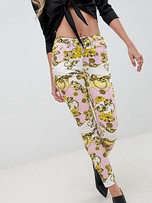 ASOS DESIGN Ridley Scarfmönstrade smala jeans med hög midja Scarfmönster