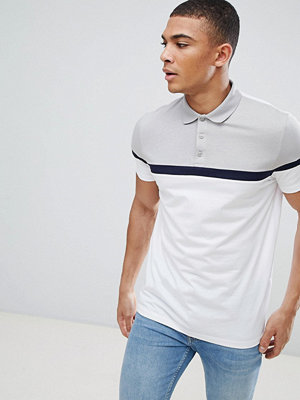 ASOS DESIGN polo shirt with cut and sew panels
