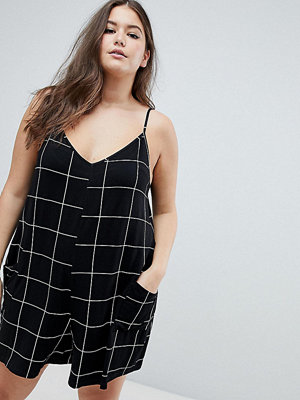 ASOS Curve ASOS DESIGN Curve jersey minimal playsuit with pockets in check - Check