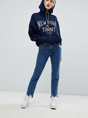 Tommy Jeans High Rise Slim Izzy Jeans With Distressed Hem - Ollie mid blue