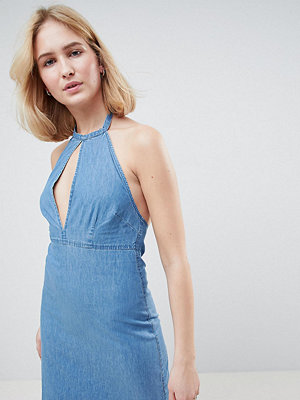 Asos Tall ASOS DESIGN Tall denim halter neck mini dress in midwash blue