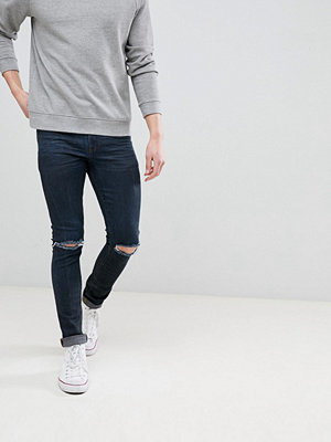 ASOS DESIGN Super Skinny Jeans In Overdyed Black With Abrasions