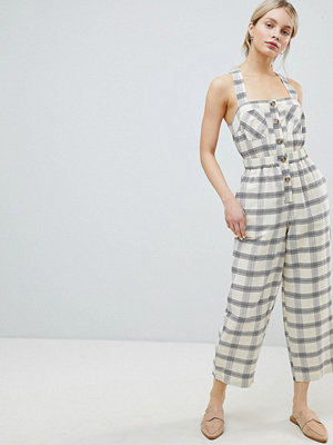 ASOS DESIGN Jumpsuit With Elasticated Waist And Button Detail In Check - Ivory check