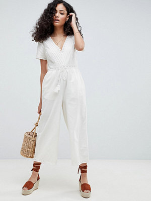 ASOS DESIGN Cotton Embroidered Jumpsuit With Tassel Trim