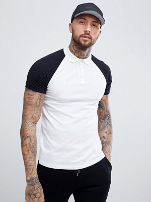 ASOS DESIGN polo in jersey with contrast raglan sleeves - Wht/ blk