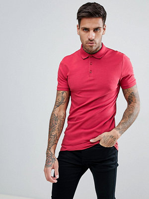 ASOS DESIGN muscle fit polo in pique - Ruby woo
