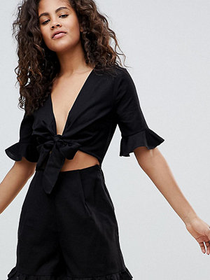 Asos Tall ASOS DESIGN Tall playsuit with cut out and tie detail in linen