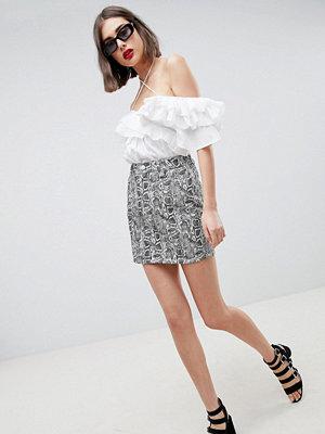 ASOS DESIGN denim original skirt in snake print - Black/ white