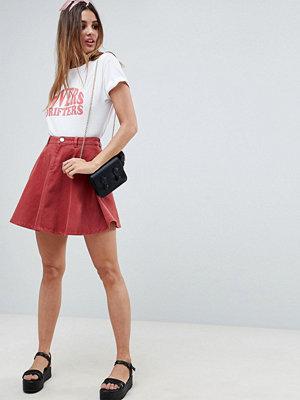 ASOS DESIGN denim circle skirt in rust - Rust