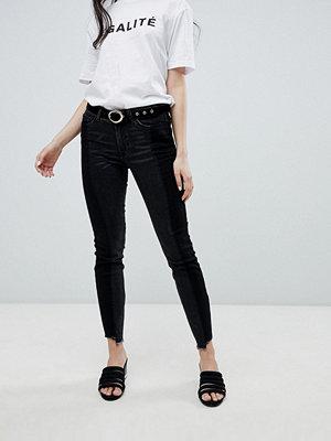 Vila Jeans med asymmetrisk nederkant