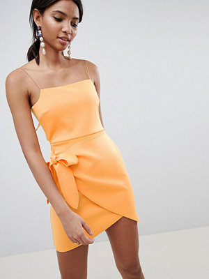 ASOS DESIGN wrap front bow scuba mini dress