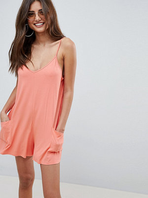 ASOS DESIGN jersey minimal playsuit with pockets - Peach