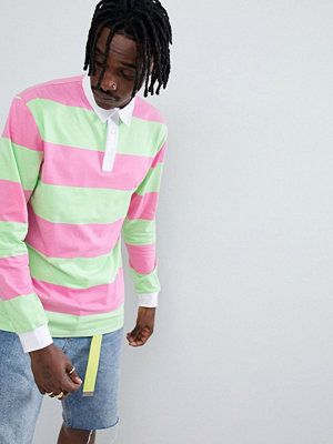 ASOS DESIGN relaxed long sleeve rugby polo with bright stripe