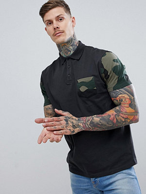 ASOS DESIGN relaxed polo with camo sleeve and pocket