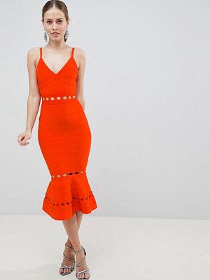ASOS DESIGN premium bandage midi dress with pephem and cut out detail
