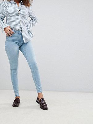 Parisian Skinny jeans med fransiga benslut Ljusblå