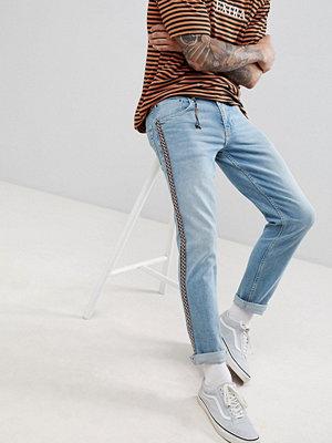 Jeans - ASOS DESIGN Slim Jeans In Light Wash Blue With Aztec Side Stripe - Light wash blue
