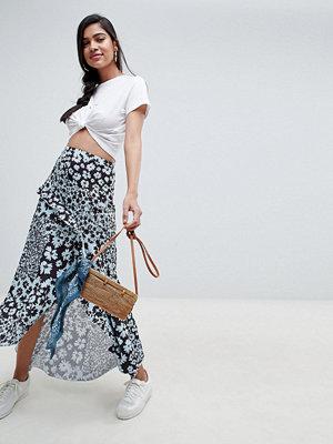 ASOS DESIGN mixed blue floral maxi skirt with hanky hem