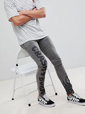 Jeans - ASOS DESIGN Extreme Super Skinny Jeans in Black With Black Prints