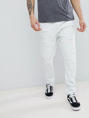 ASOS DESIGN Drop Crotch Jeans In Bleach Wash Blue With Extreme Rips - Light wash blue