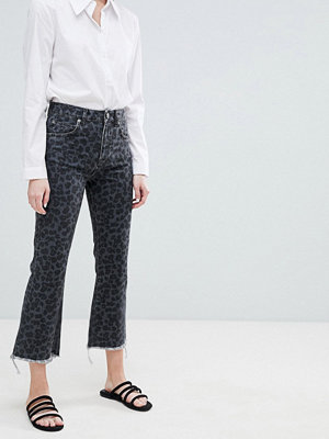 ASOS DESIGN Egerton rigid cropped flare jeans in dark leopard print