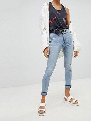 Cheap Monday Blekta jeans med extra smal passform och hög midja Bite blue