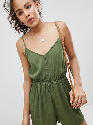 Asos Tall ASOS DESIGN Tall playsuit in crinkle with button front - Khaki