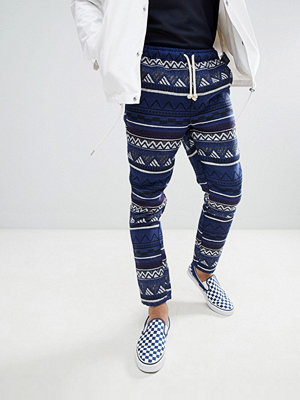ASOS DESIGN Festival Tapered Trousers In Blue Aztec Jacquard With Elasticated Waist - Blue