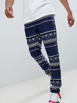 ASOS DESIGN Tall Festival Tapered Trousers In Blue Aztec Jacquard With Elasticated Waist