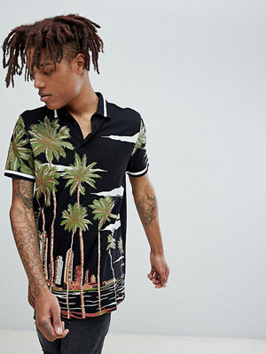ASOS DESIGN longline polo with landscape print