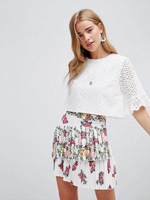 ASOS DESIGN rose printed pleated mini skirt