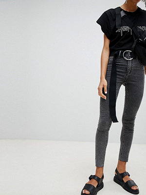 Cheap Monday Svarta jeans med hög midja och extra smal passform Svart grime