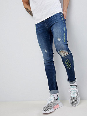 ASOS DESIGN extreme super skinny jeans in dark wash blue with rips and embroidery - Dark wash blue