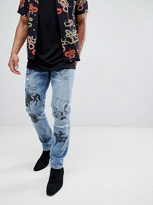 ASOS DESIGN Slim Jeans In Mid Wash Blue With Western Prints - Mid wash blue