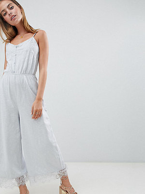 ASOS Petite ASOS DESIGN Petite cami jersey jumpsuit with lace trim and button front