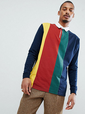 ASOS DESIGN relaxed rugby polo shirt with vertical colour block
