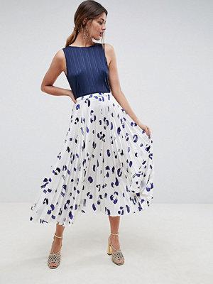 ASOS DESIGN satin pleated midi skirt in spot print